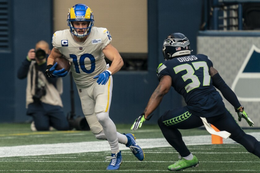 Rams wide receiver Cooper Kupp runs with the ball against the Seattle Seahawks on Dec. 27, 2020.