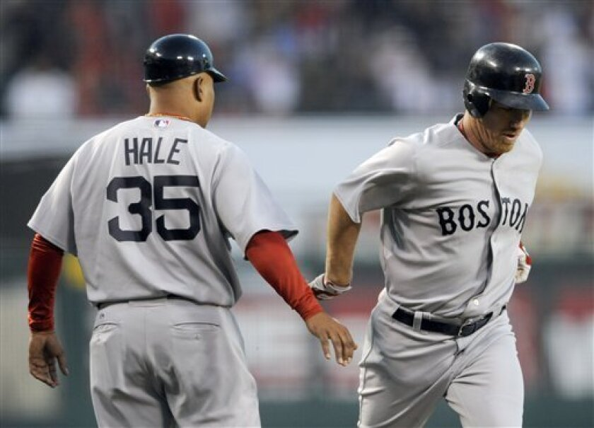 Boston Red Sox's J.D. Drew, right, shakes hands with third base coach DeMarlo Hale after hitting a solo home run against the Los Angeles Angels in the second inning of a baseball game in Anaheim, Calif., Tuesday, May 12, 2009. (AP Photo/Matt A. Brown)