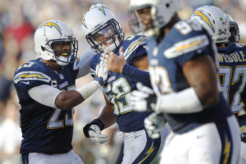 Chargers Andrew Gachkar celebrates with Darrell Stuckey, left, after he recovered a fumble and ran it in for a touchdown against the Rams in the 3rd quarter.