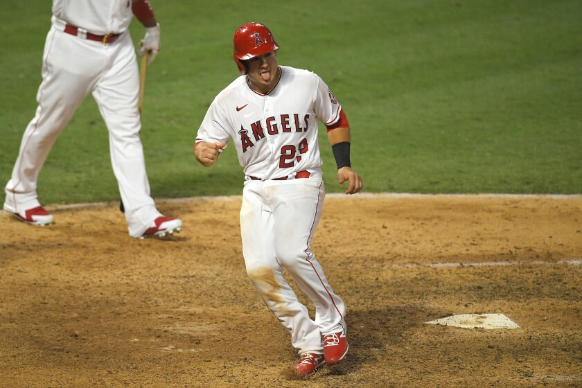 The Angels' Matt Thaiss reacts after scoring on a sacrifice fly hit by Michael Hermosillo to win the game Aug. 1, 2020.