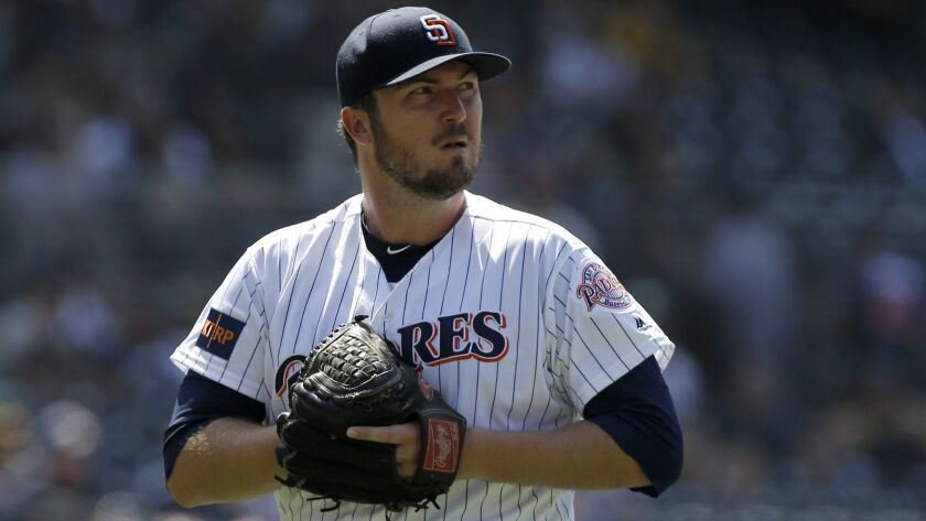 San Diego Padres relief pitcher Phil Hughes walks off the mound during the seventh inning of a baseb