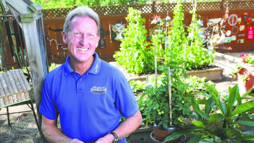 "Steve Scott at the edge of his garden at his Carlsbad home Sunday. ""This is my sanity place,"" he sai"