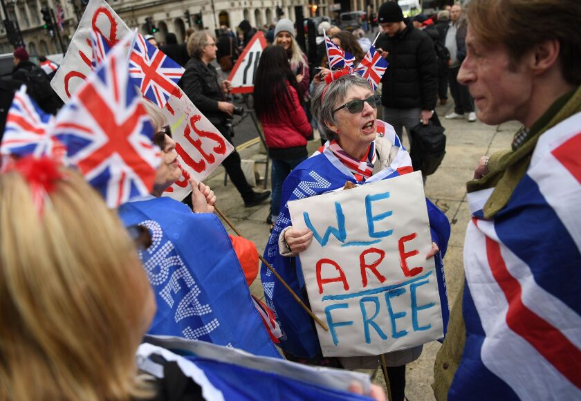 Brexit supporters rally outside Parliament in London on Friday as Britain officially exits the EU.