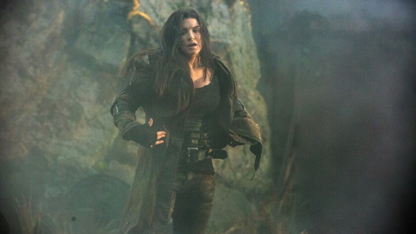 "Gina Carano is game as bounty hunter Attica Gage in ""Scorched Earth,"" but she can't save the sluggishly executed apocalyptic tale."