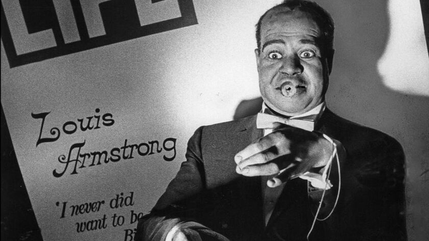 Sep. 13, 1972: Something missing - wax figure of Louis Armstrong stands without his familiar tradema