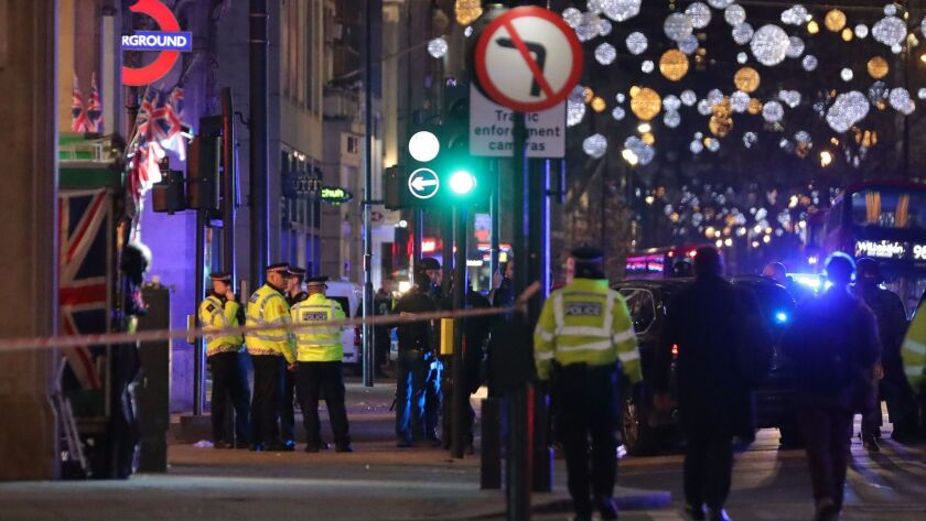 Police set up a cordon outside the Oxford Circus underground station in central London where gunfire was reported on Friday.