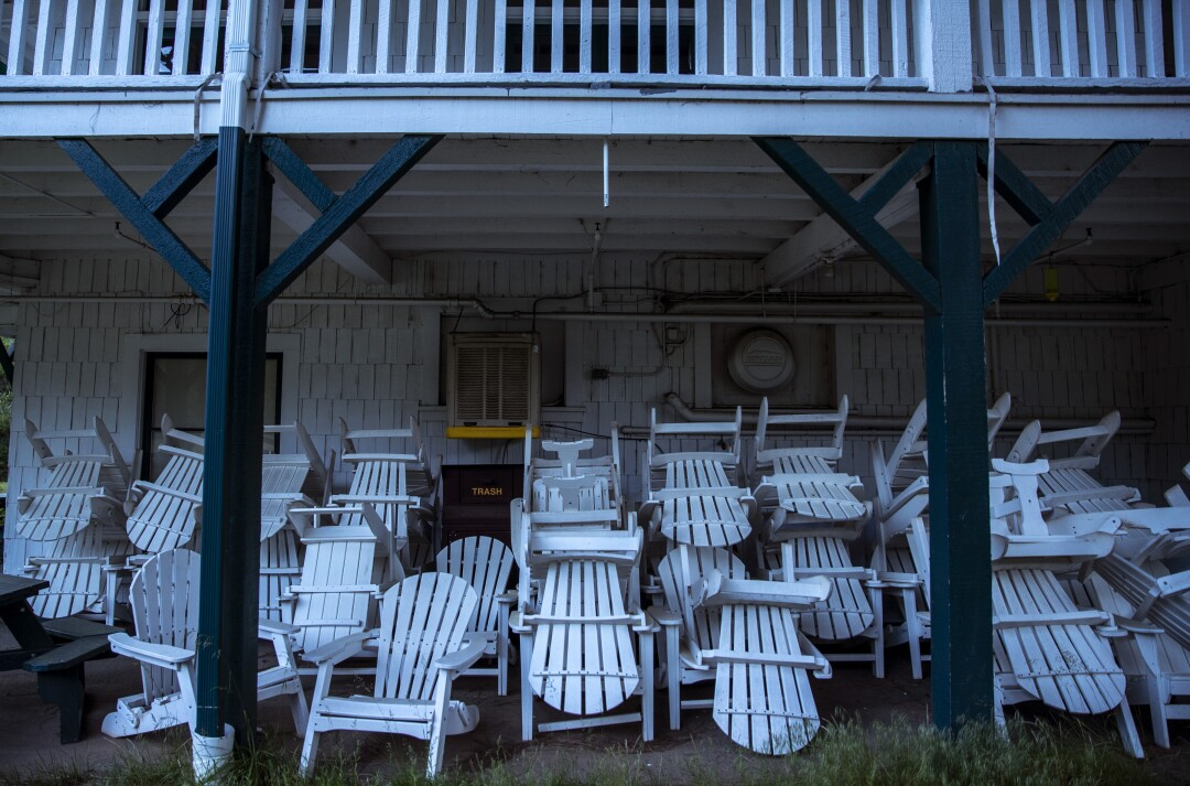Adirondack chairs are stacked under the balcony at Big Trees Lodge in Wawona.