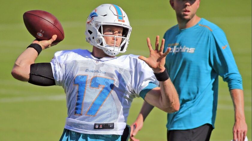 Miami Dolphins quarterback Ryan Tannehill (17) throws during NFL football practice, Tuesday, Nov. 20