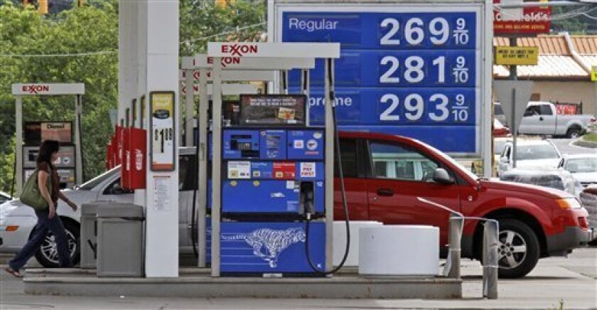 Prices are displayed at an an Exxon gas station in Heidleberg, Pa., Tuesday, June 8, 2010. Oil prices rose to near $75 a barrel Wednesday, after Fed Chairman Ben Bernanke said European debt problems should not have a major impact on the U.S. economy.(AP Photo/Gene Puskar)