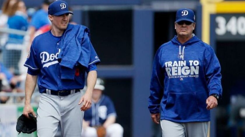Dodgers pitching coach Rick Honeycutt, right, with pitcher Ross Stripling on March 29, 2016.