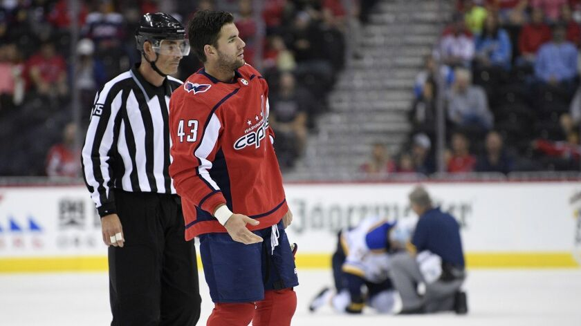 Washington Capitals right wing Tom Wilson (43) is escorted by an official off the ice after he check