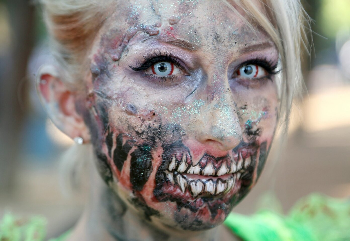 Michelle Stubblefield of Los Angeles prepares to participate in the Zombie Walk at San Diego Comic-Con 2016. #sdcc2016