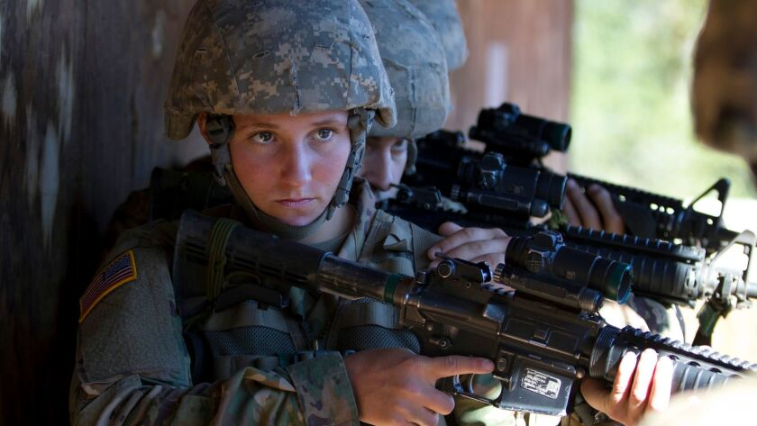 In this Oct. 4, 2017, photo, a female U.S. Army recruit practices building-clearing tactics with male recruits at Ft. Benning, Ga. The Army's introduction of women into the infantry has moved steadily but cautiously this year.