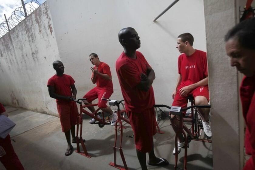Brazil prisoners ride bikes toward prison reform