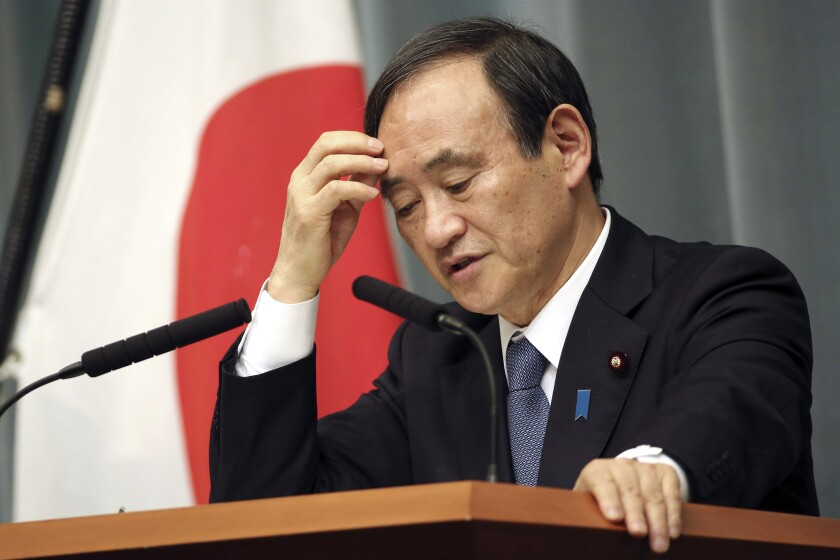 FILE - In this Feb. 1, 2015, file photo, Japan's Chief Cabinet Secretary Yoshihide Suga speaks during a press conference at the prime minister's official residence in Tokyo after the release of an online video that purported to show an Islamic State group militant beheading Japanese journalist Kenji Goto. Suga, a longtime loyal assistant and the public face of outgoing Prime Minister Shinzo Abe in daily media briefings, has emerged as a favorite to succeed him in an upcoming internal party vote. Suga is set to announce his candidacy and key policies later Wednesday, Sept. 2, 2020. (AP Photo/Eugene Hoshiko, File)
