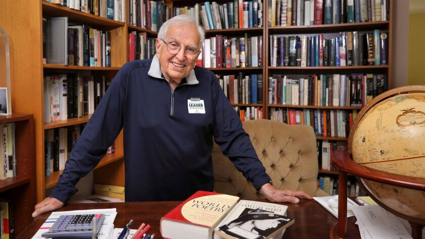 George Tsoris, 90, in the study of his Oceanside home. He recently received a national award for his volunteer work teaching poetry to children at the Boys & Girls Club of Vista.