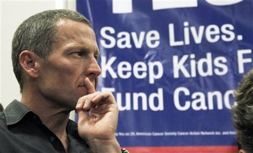 FILE - In this May 11, 2012 file photo, cycling legend and cancer survivor Lance Armstrong attends a rally at a news conference at Children's Hospital in Los Angeles in favor of Proposition 29, a measure on the June 2012 California primary election ballot that would add a $1-per-pack tax on cigaret