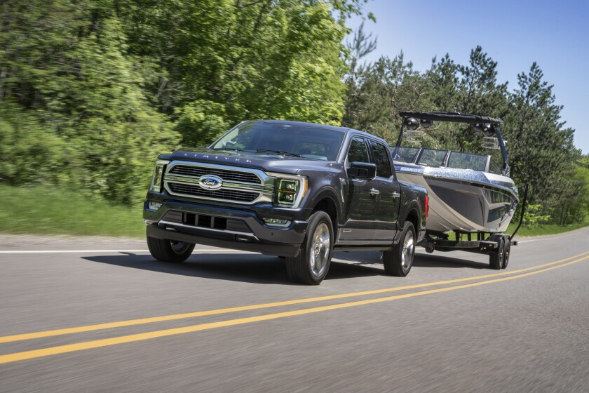 This photo provided by Ford Motor Co. shows the 2021 Ford F-150, which is the Edmunds Top Rated full-size pickup truck. With several available powertrains and body configurations, the F-150 has many different towing capacities, but that number is affected by axle ratio as well. (Courtesy of Ford Motor Co. via AP).