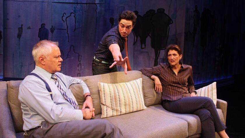 """Ethan (Ben Feldman) talks to his ex's puzzled parents (Matthew Arkin and Amy Aquino) in """"The Siegel."""