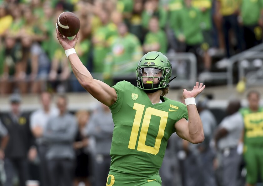 Oregon quarterback Justin Herbert throws a touchdown pass against Portland State during the first quarter of a game Sept. 8 at Autzen Stadium.