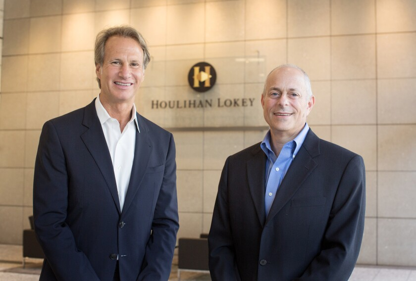 Los Angeles-based investment bank Houlihan Lokey is preparing an initial public offering. Above left is the firm's executive chairman, Irwin Gold, with Chief Executive Scott Beiser.