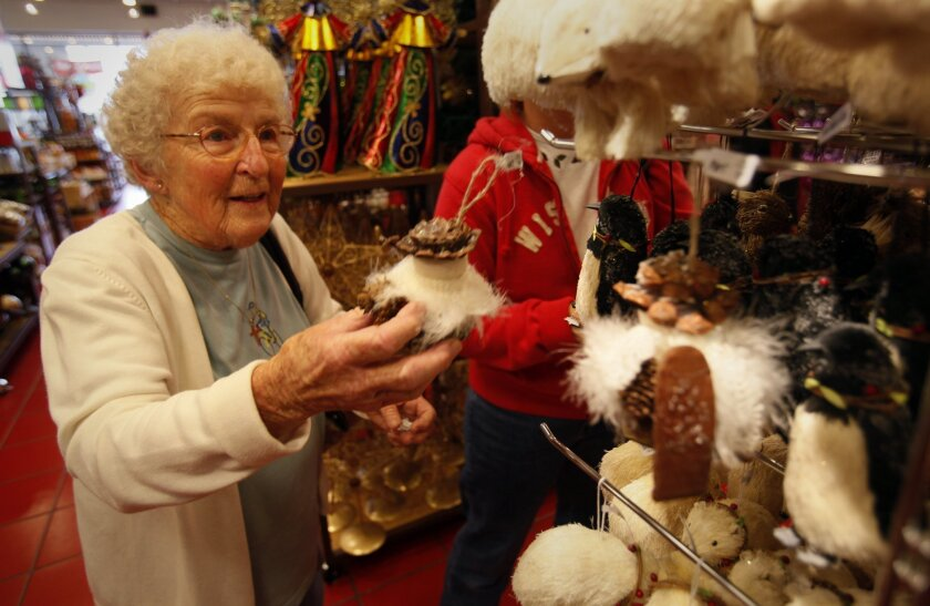 Joanie Mutter enjoys looking at holiday ornaments Sunday at Pier 1 Imports in Grossmont Center in December 2010,  while shopping with her daughter Vickie Higgins, right (behind display). Peggy Peattie • U-T