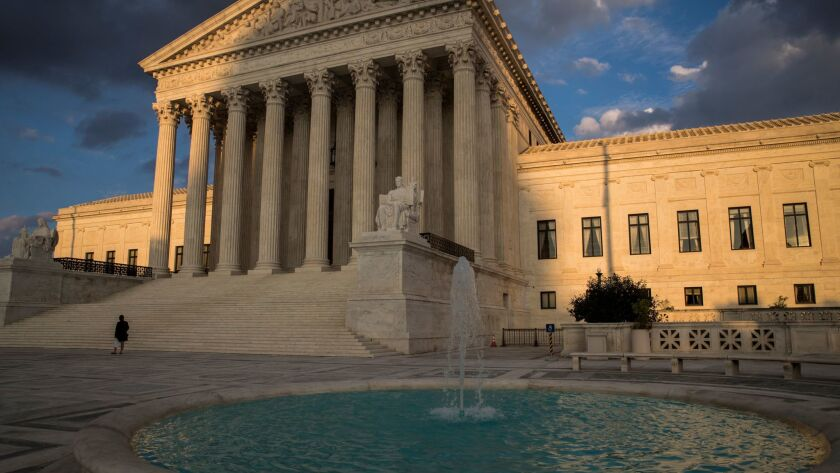 In this Oct. 10, 2017, photo, the Supreme Court in Washington is seen at sunset.