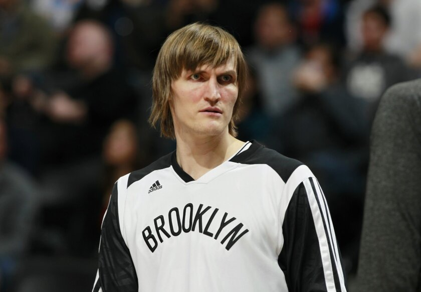 FILE - This Feb. 27, 2014, file photo shows Brooklyn Nets forward Andrei Kirilenko during an NBA game against the Denver Nuggets, in Denver. Former NBA player Andrei Kirilenko has been elected president of the troubled Russian Basketball Federation. The ex-Utah Jazz and Brooklyn Nets small forward, who spent 13 seasons in the NBA, was elected unopposed at a conference Tuesday, Aug. 25, 2015, in Moscow _ hours after his only rival, Russian national team general manager Dmitry Domani, withdrew from the contest. (AP Photo/David Zalubowski, File)