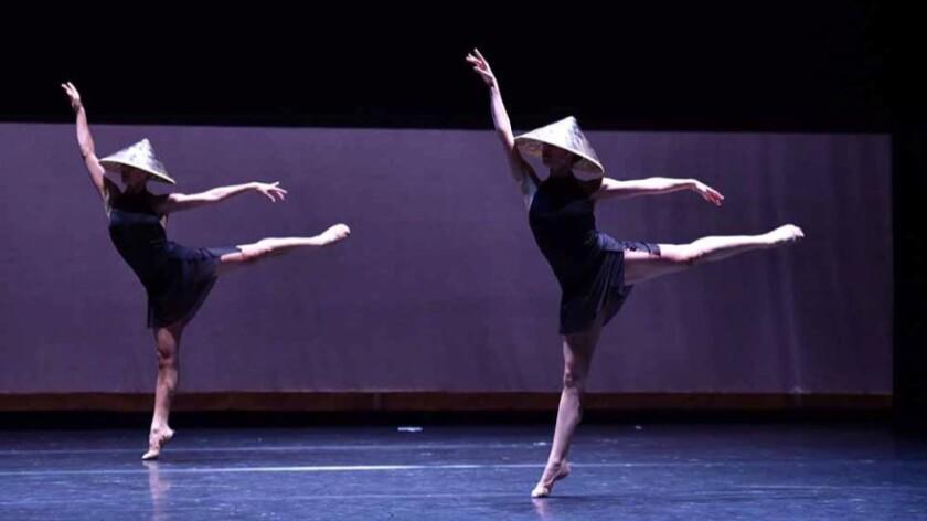 """""""Festive Devotions,"""" choreographed by Norbert De La Cruz III and danced by Stephanie Kim and Jessica Gadzinski."""