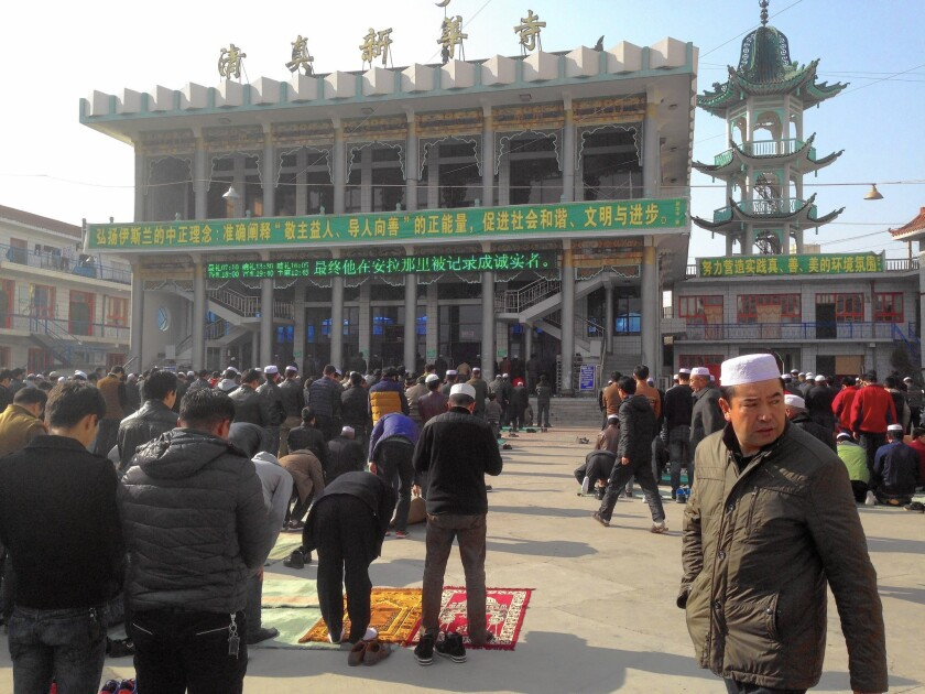 People converge on the Xinhua Mosque in Linxia, China, for Friday prayers.