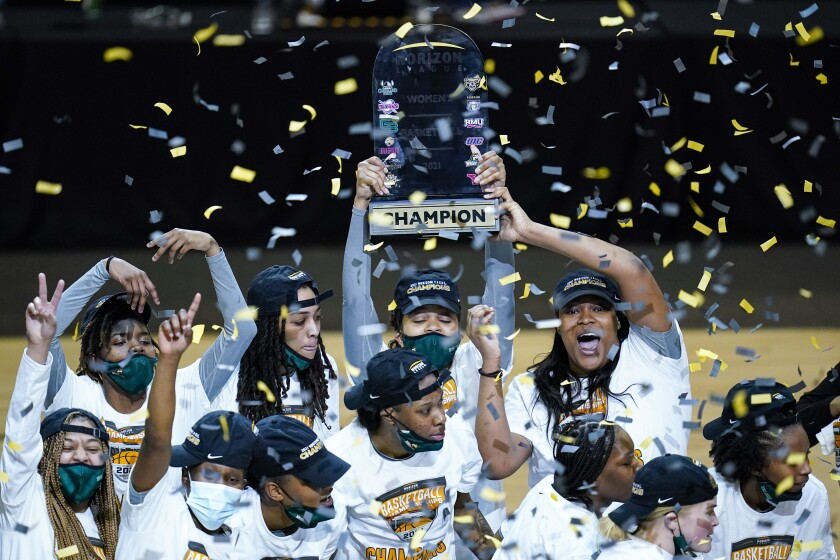 Wright State celebrates after defeating IUPUI 53-41 in the championship NCAA college basketball game in the women's Horizon League conference tournament in Indianapolis, Tuesday, March 9, 2021. (AP Photo/Michael Conroy)