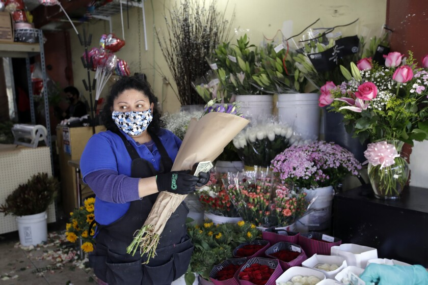 Evelyn Linares sells flowers at the Los Angeles Flower Market on May 6.