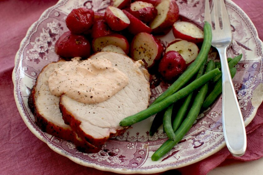 This Jan. 25, 2016 photo shows honey oregano pork loin in Concord, N.H. This dish is from a recipe by Katie Workman. (AP Photo/Matthew Mead)
