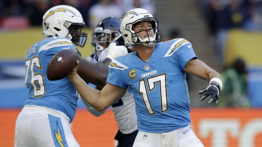 FILE - In this Sunday, Oct. 21, 2018 file photo,Los Angeles Chargers quarterback Philip Rivers (17)