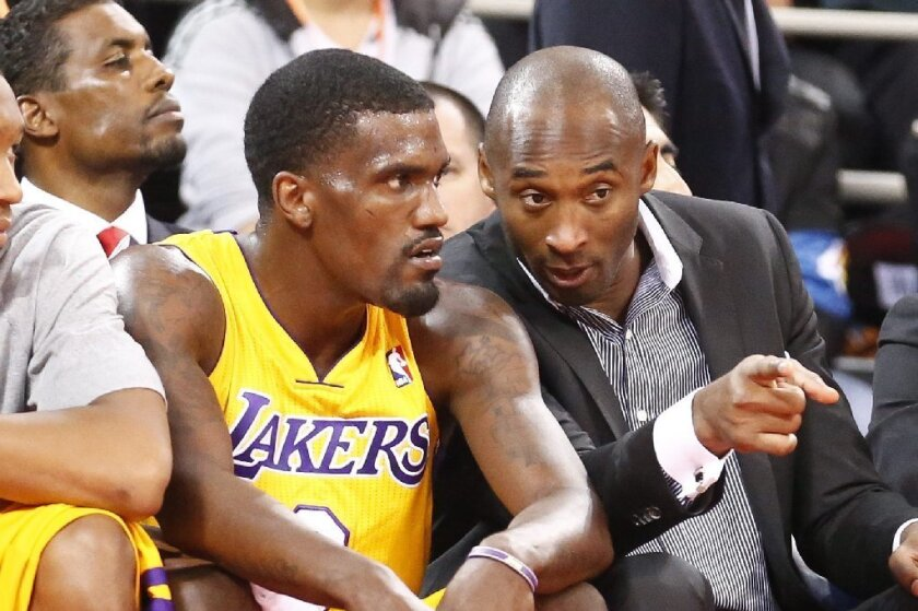 Kobe Bryant talks to Darius Johnson-Odom during an exhibition game between the Lakers and Golden State in Beijing on Tuesday.