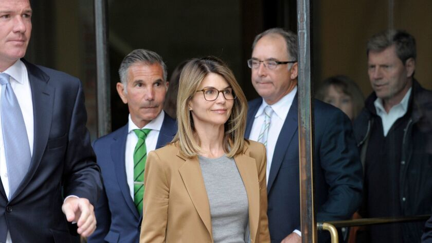 Actress Lori Loughlin exits a Boston courthouse after facing charges in the college admissions scandal on April 3.