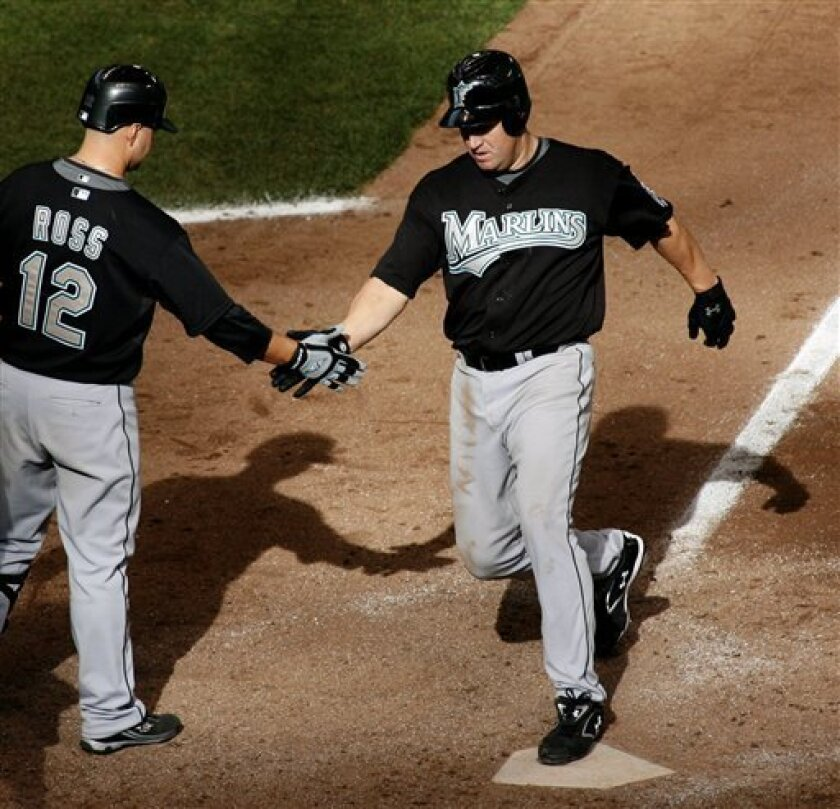 Florida Marlins' Wes Helms is congratulated by Cody Ross, left, after he hit the game winning home run against the Milwaukee Brewers in the tenth inning of a baseball game Sunday April 27, 2008 in Milwaukee. (AP Photo/Darren Hauck)