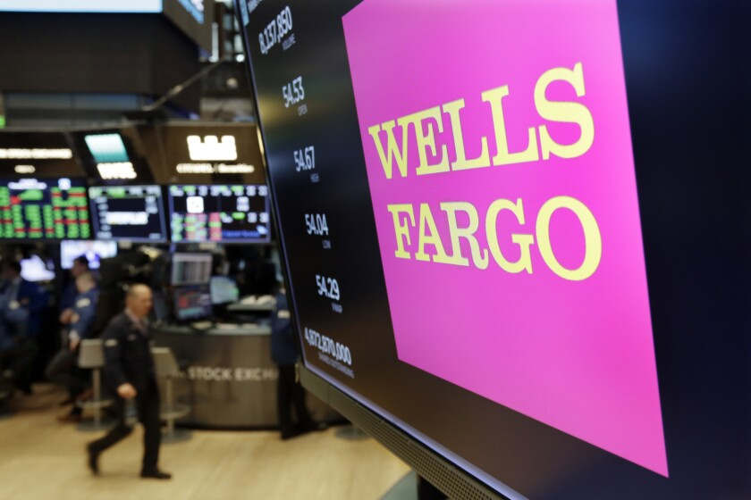 Wells Fargo is selling more than 50 retail bank branches in Indiana, Michigan, Wisconsin and Ohio to a Flagstar Bancorp subsidiary.