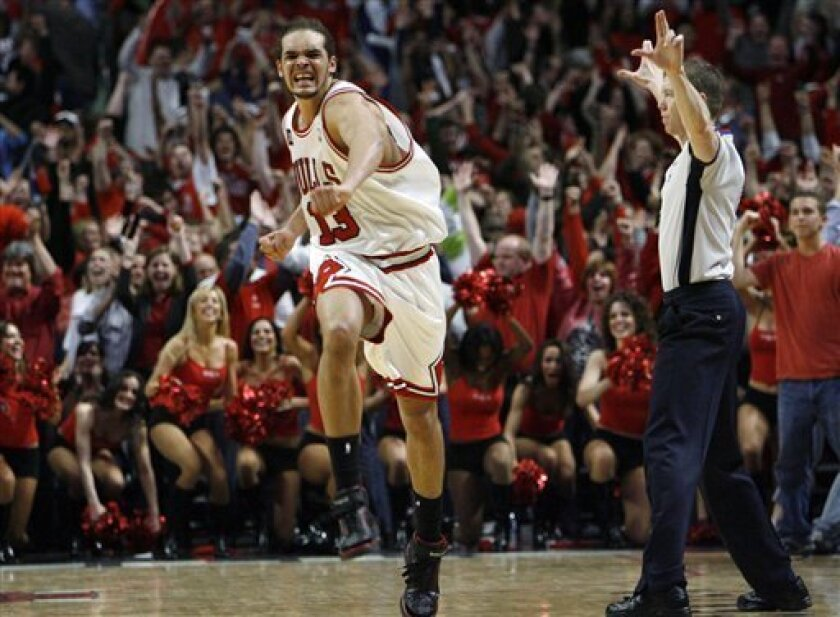 Chicago Bulls' Joakim Noah celebrates after the Bulls defeated the Boston Celtics 128-127 in triple overtime during Game 6 of a first-round NBA basketball playoff series, Thursday, April 30, 2009, in Chicago. (AP Photo/Nam Y. Huh)