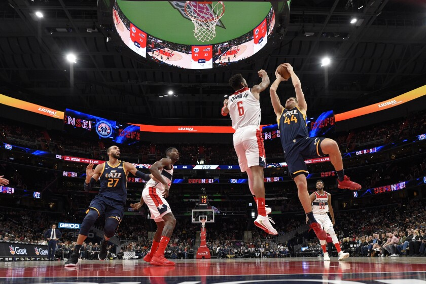 Utah Jazz forward Bojan Bogdanovic (44) goes to the basket next to Washington Wizards guard Troy Brown Jr. (6) during the first half of an NBA basketball game, Sunday, Jan. 12, 2020, in Washington. (AP Photo/Nick Wass)