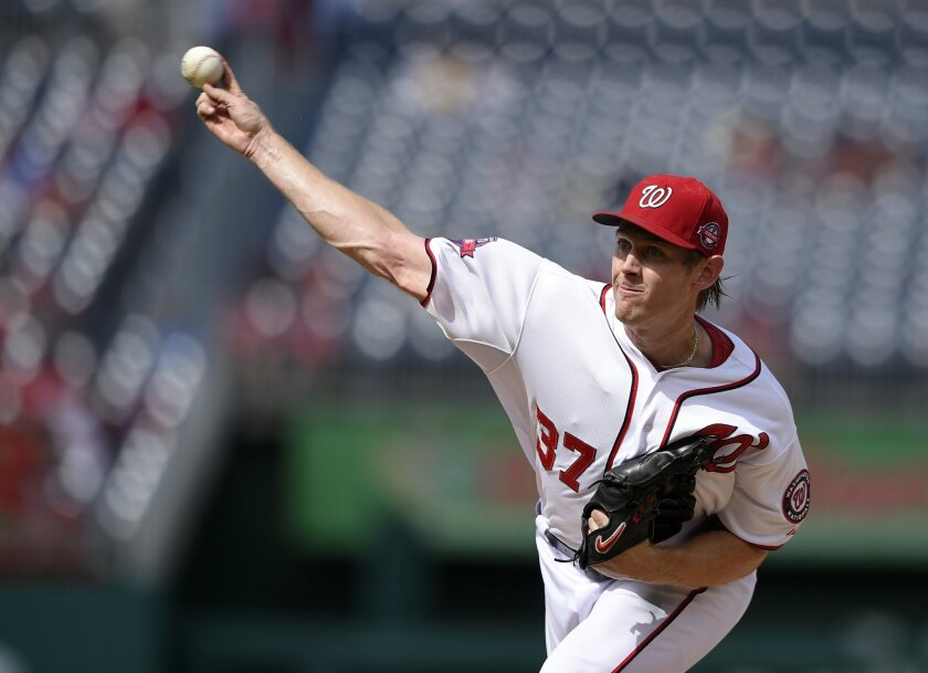 Washington Nationals starting pitcher Stephen Strasburg (37) delivers a pitch against the Miami Marlins during the fourth inning of a baseball game, Sunday, Sept. 20, 2015, in Washington. (AP Photo/Nick Wass)