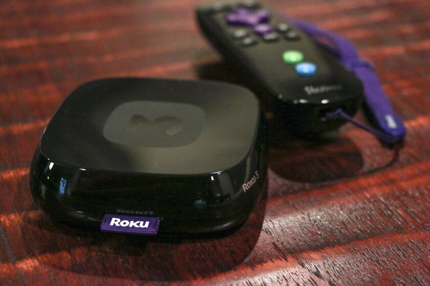 FILE - This Sept. 29, 2014, file photo, shows the Roku 3, a product for streaming popular video services, apps and games in high-definition, in Decatur, Ga. Moving the traditional cable bundle online, stripped down to fewer channels and freed from ugly cable boxes, is all the rage these days. The R