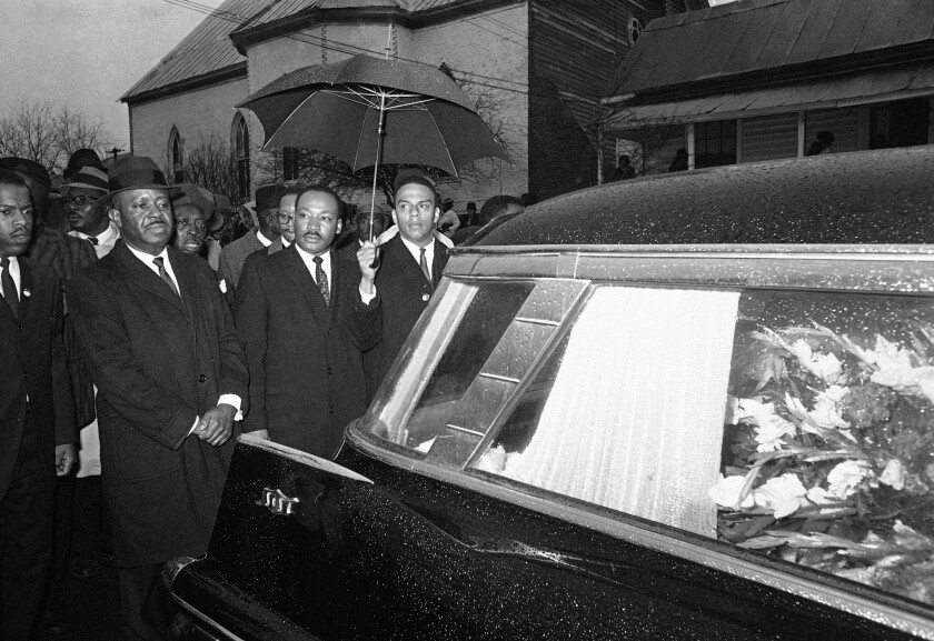 FILE - In this March 1, 1965, photo, the Rev. Martin Luther King Jr. and associates lead a procession behind the casket of Jimmie Lee Jackson during funeral rites at Marion, Ala. From left, John Lewis, the Rev. Ralph Abernathy, King and the Rev. Andrew Young. In 1965, Jackson was fatally shot at a protest in Marion. It was that killing that sent hundreds of people to Selma for a march at the Edmund Pettus Bridge two weeks later. (AP Photo/File)