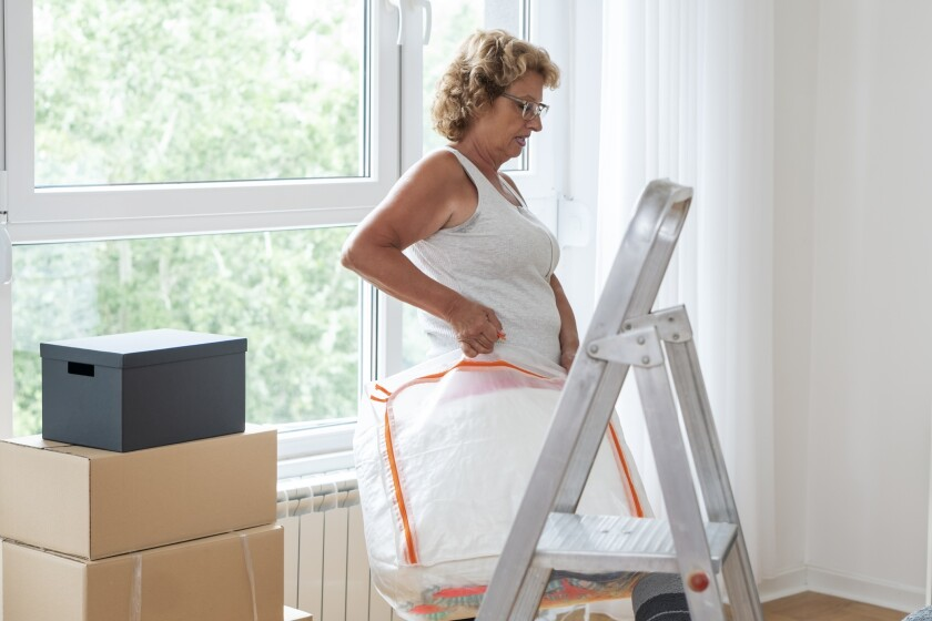 Senior woman moving into a new apartment