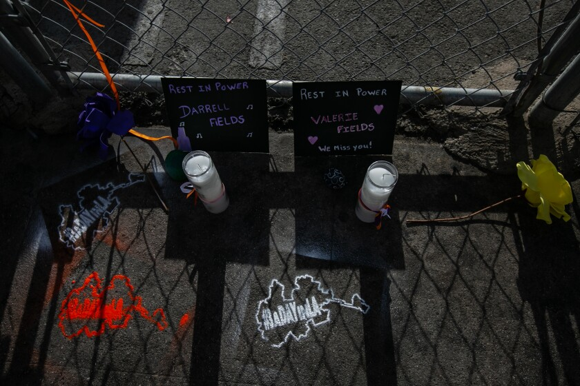 A memorial sits Friday at the site where homeless man Darrel Fields was set on fire and died.