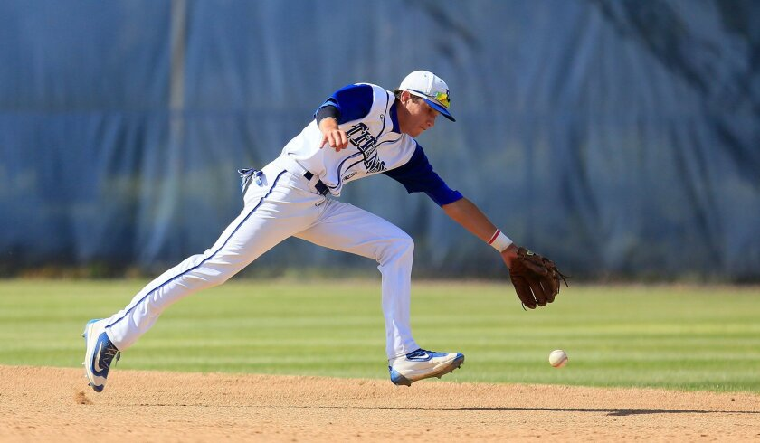 Eastlake shortstop Ben Ramirez reaches for a ground ball in the Titans' 6-5 playoff win over Grossmont on Wednesday.