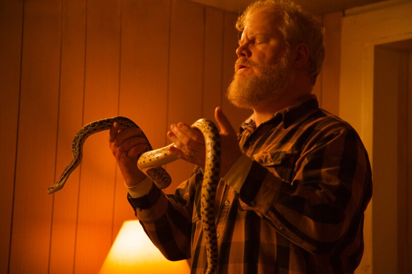 """Jim Gaffigan handles a snake in a scene from """"Them That Follow."""""""