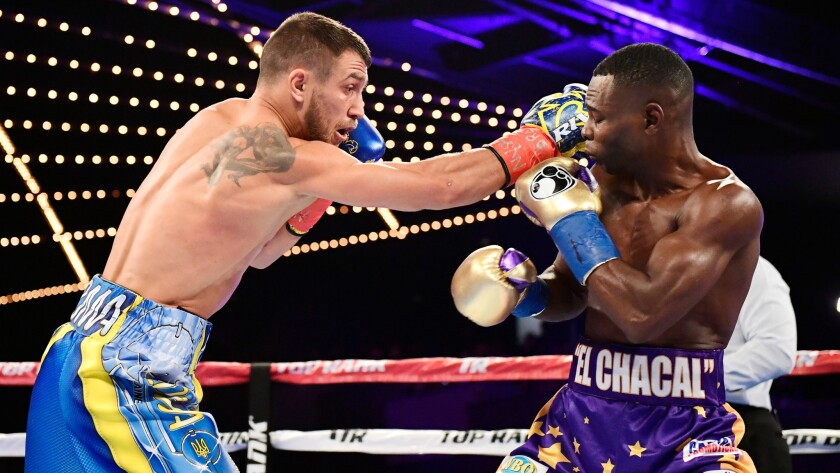 Vasiliy Lomachenko lands a punch against Guillermo Rigondeaux during their super-featherweight title fight Saturday at Madison Square Garden.