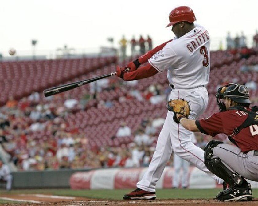 Cincinnati Reds' Ken Griffey Jr. hits a solo home run off Houston Astros pitcher Chris Sampson in the first inning of a baseball game, Wednesday, April 23, 2008, in Cincinnati. The home run was the 597th of Griffey's career. Astros catcher J.R. Towles watches at right. (AP Photo/Al Behrman)