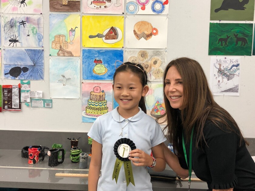 Del Mar Pines fifth-grader Veronica Yu received a first place ribbon after her drawing (directly over her right shoulder) was selected by pastry chef Karen Krasne.